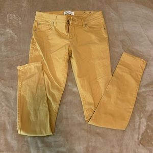 Yellow fitted jeans from express